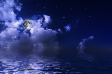 The moon over the water under the stars
