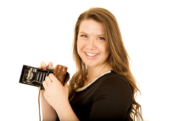 Pretty young woman with an old school camera smiling