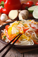 rice noodles with vegetables and ingredients. Vertical