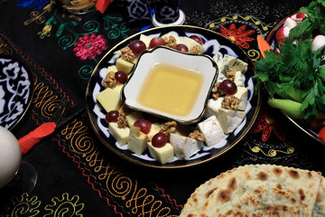 Plate with honey and various cheese
