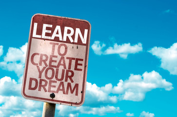 Learn To Create Your Dream sign with sky background