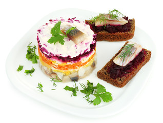 Russian herring salad  and sandwiches on plate isolated on