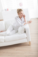 beautiful young blond woman speaking at phone