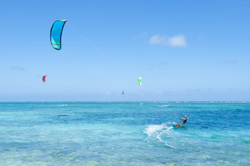 Kite surfer on clear blue tropical water, Okinawa, Japan