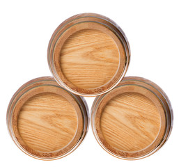 three wood casks on white