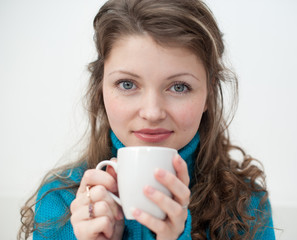 Soft photo of woman with cup of coffee in hands