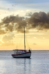 Fishing boat in sunset off Curacao coast