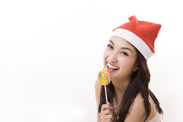 happy smile girl wearing a santa suit holding a candy for christ