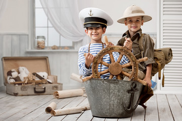 Boys playing captain and traveler