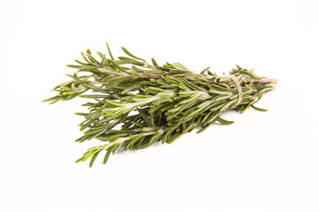 Bunch of rosemary tied up twine on a white background