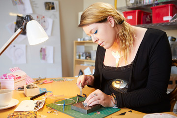 Young Woman Making Jewelry At Home