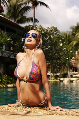 sexy girl in bikini and sunglasses relaxing in Thailand