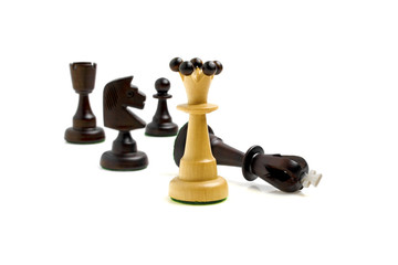 White queen and black chess pieces on a white background