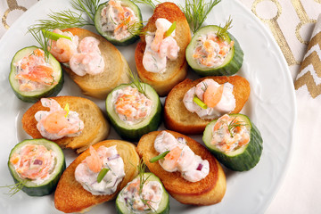 Fresh snack with salmon and shrimp on a plate