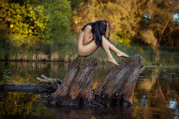 Spoed Foto op Canvas Fantasie Landschap Naked girl on the lake.