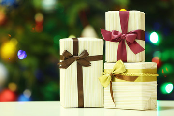 Gift boxes on Christmas tree lights background