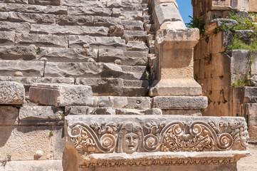 Stone mask and ancient amphitheater, Myra (Turkey)