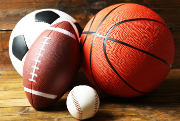 Sports balls on wooden background