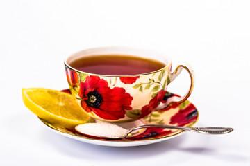 red mug of tea with lemon