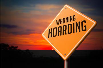 Hoarding on Warning Road Sign.
