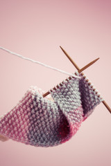 Knitted yarn with a pair of knitting needles