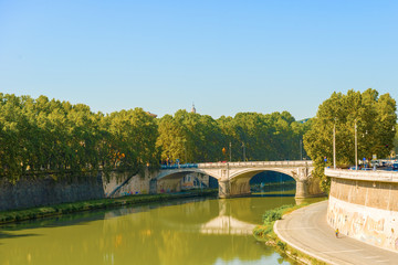 Bridge over Tiber river in Rome, Italy.