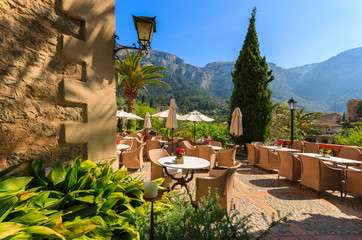 Wall Mural - Local restaurant terrace in Deia village, Majorca island, Spain