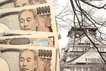 Japanese yen with Osaka castle as background