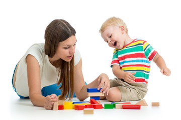 kid and his mom play toys together