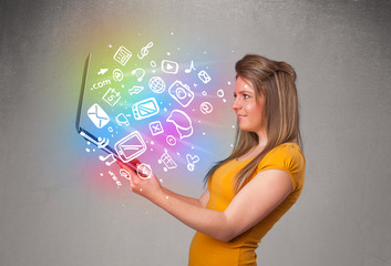 Young lady holding notebook with colorful hand drawn multimedia