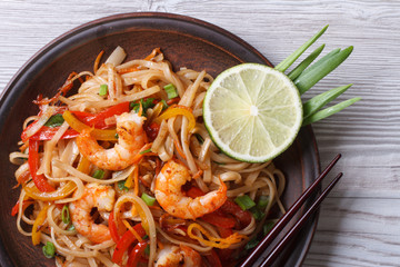 Asian rice noodles with shrimp and vegetables top view