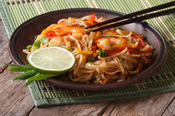 Asian food: rice noodles with shrimp and vegetables