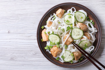 salad of rice noodles with chicken and cucumbers top view