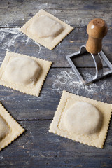 homemade stuffed ravioli big size on wooden table