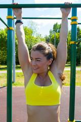 Athlete woman stretching on playground