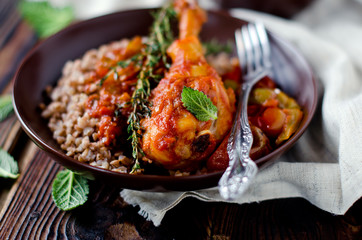 Chicken in tomato sauce with a side dish of buckwheat, rosemary,