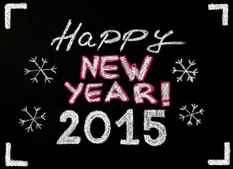 Happy new year 2015, hand writing with chalk on blackboard