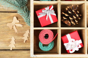 Beautiful Christmas composition with gifts in wooden crate