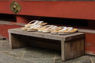 geta sandals left outside Buddhist shrine