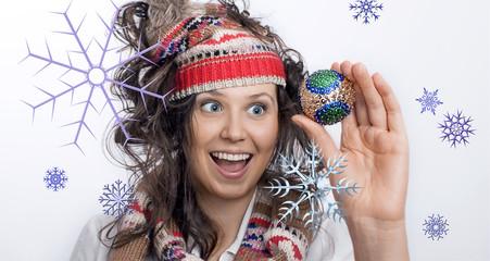 Smiling Christmas Girl and a hand with Christmas toy
