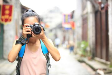 young woman photographer taking photo,yangshuo,china