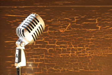 Silver vintage microphone in the studio on wood background