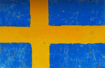 Flag of Sweden on concrete wall