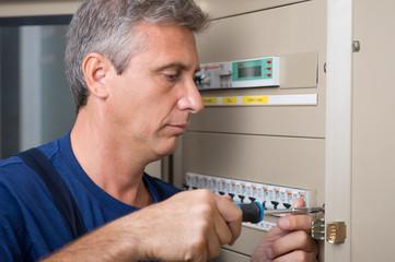 Electrician Repairing A Circuit Breaker