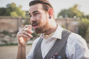 handsome big moustache hipster man smoking cigarette