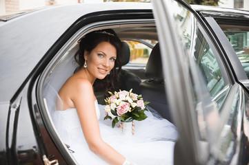 Young bride in a wedding car