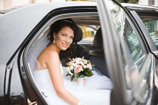 Young bride in a wedding car