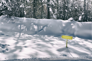 Yellow arrow in deep snow