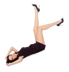 Happy female in black dress lie on the floor