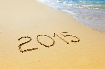 New year 2015 written on sand